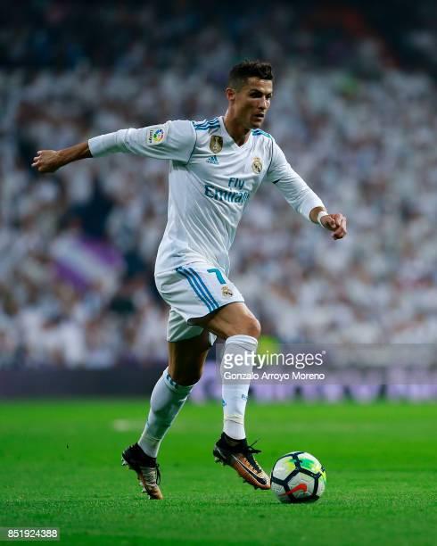Cristiano Ronaldo of Real Madrid CF controls the ball during the La Liga match between Real Madrid CF and Real Betis Balompie at Estadio Santiago...