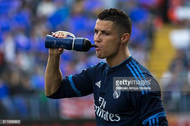 Cristiano Ronaldo of Real Madrid CF drinks from a bottle prior to start the La Liga match between Malaga CF and Real Madrid CF at La Rosaleda Stadium...