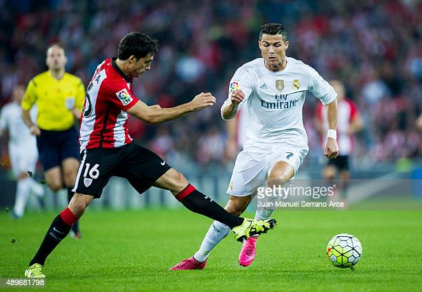 Cristiano Ronaldo of Real Madrid CF duels for the ball with Xabier Etxeita of Athletic Club Bilbao during the La Liga match between Athletic Club...
