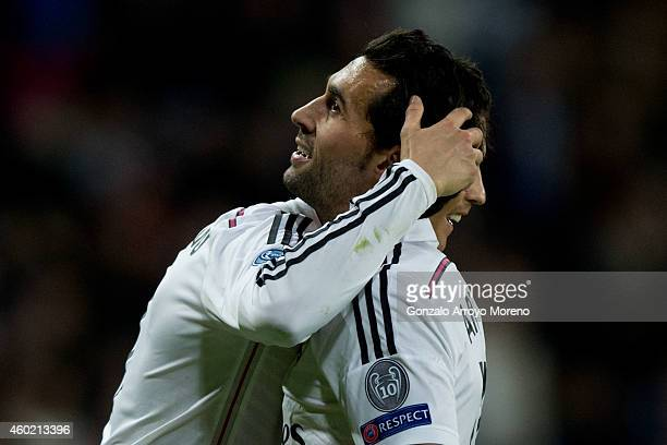 Cristiano Ronaldo of Real Madrid CF embraces his teammte Alvaro Arbeloa congratulating him for his third goal during the UEFA Champions League Group...