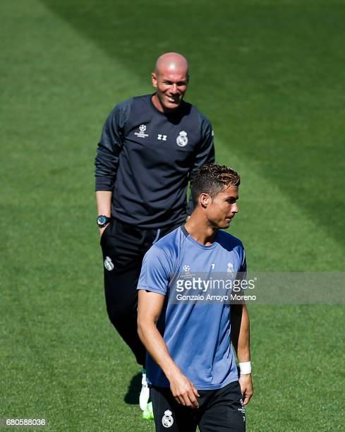 Cristiano Ronaldo of Real Madrid CF excersisesahead his coach Zinedine Zidane during a training session ahead of the UEFA Champions League Semifinal...