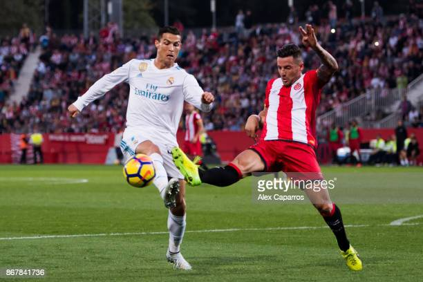 Cristiano Ronaldo of Real Madrid CF fights for the ball with Francisco Aday of Girona FC during the La Liga match between Girona and Real Madrid at...
