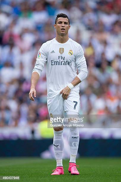 Cristiano Ronaldo of Real Madrid CF fixes his shorts prior to start the La Liga match between Real Madrid CF and Malaga CF at Estadio Santiago...