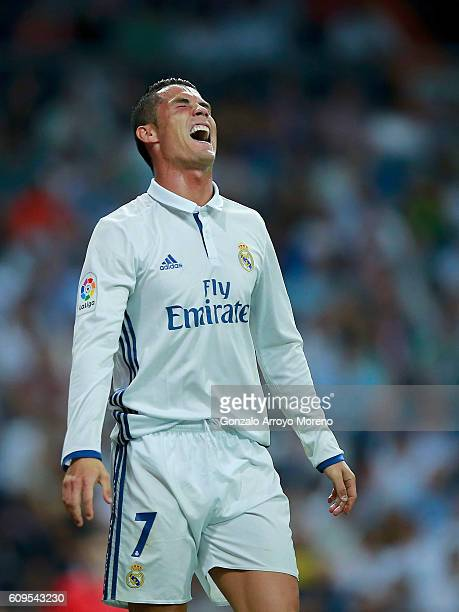 Cristiano Ronaldo of Real Madrid CF grimaces in pain during the La Liga match between Real Madrid CF and Villarreal CF at Santiago Bernabeu stadium...