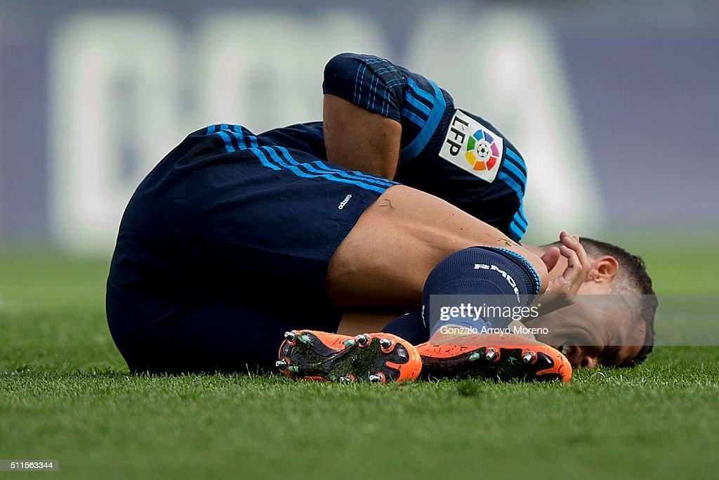 Cristiano Ronaldo of Real Madrid CF grimmaces in pain during the La Liga match between Malaga CF and Real Madrid CF at La Rosaleda Stadium on February 21, 2016 in Malaga, Spain.