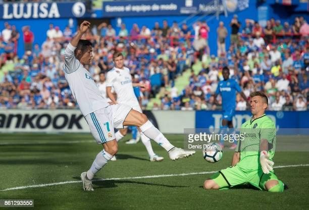 Cristiano Ronaldo of Real Madrid CF has his shot blocked by Vicente Guaita of Getafe of Getafe during the La Liga match between Getafe and Real...