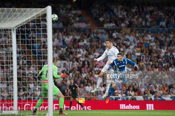Cristiano Ronaldo of Real Madrid CF heads the ball beside Mario Hermoso of RCD Espanyol during the La Liga match between Real Madrid and Espanyol at...