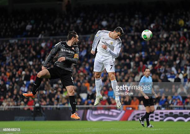 Cristiano Ronaldo of Real Madrid CF heads the ball beside Sergio Garcia of RCD Espanyol during the Copa Del Rey Quarter Final 2nd leg match between...