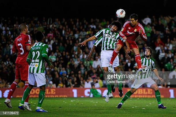 Cristiano Ronaldo of Real Madrid CF heads the ball towards goal under a challenge by Iriney Santos of Real Betis Balompie during the La Liga match...