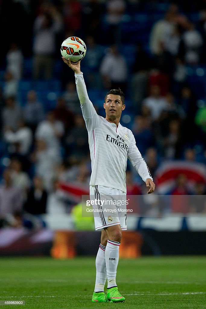 Cristiano Ronaldo of Real Madrid CF holds the ball after scoring forur goals at the end of La Liga match between Real Madrid CF and Elche CF at Estadio Santiago Bernabeu on September 23, 2014 in Madrid, Spain.