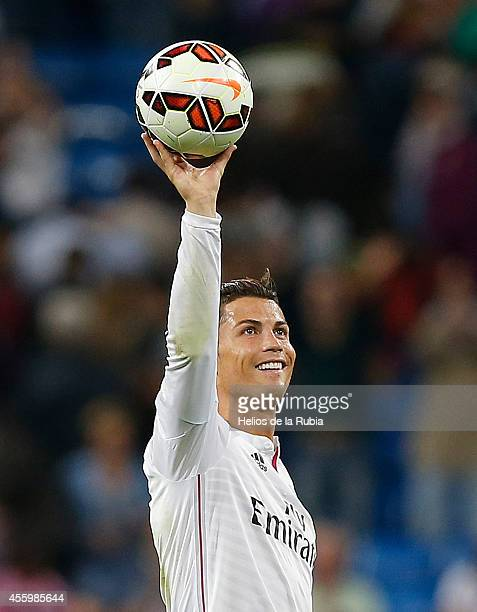 Cristiano Ronaldo of Real Madrid CF holds the ball after scoring forur goals at the end of La Liga match between Real Madrid CF and Elche CF at...