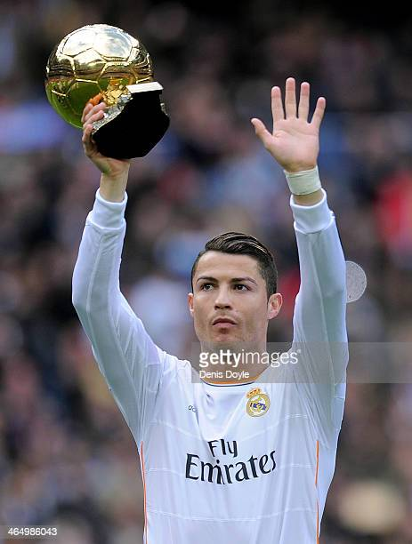 Cristiano Ronaldo of Real Madrid CF holds up the Ballon d'Or 2013 award prior to he start of the La Liga match between Real Madrid CF and Granada CF...