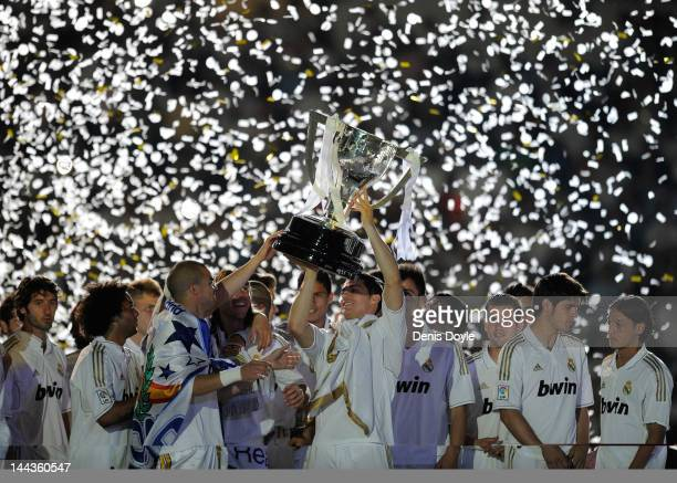 Cristiano Ronaldo of Real Madrid CF holds up the La Liga trophy as he celebrates winning the La Liga title with teammates after the La Liga match...