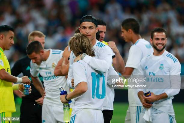 Cristiano Ronaldo of Real Madrid CF hugs his teammate Luka Modric after winning the Supercopa de Espana Final 2nd Leg match between Real Madrid and...