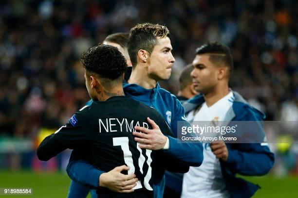Cristiano Ronaldo of Real Madrid CF hugs Neymar JR of Paris SaintGermain prior to start the UEFA Champions League Round of 16 First Leg match between...