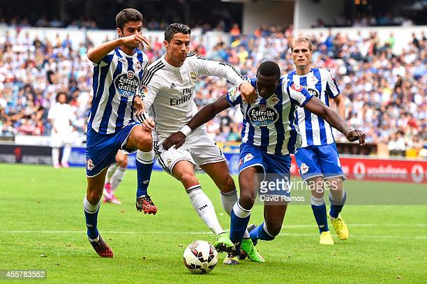 Cristiano Ronaldo of Real Madrid CF is brought down by Juan Dominguez and Modibo Diakite of RC Deportivo of RC Deportivo La Coruna during the La Liga...