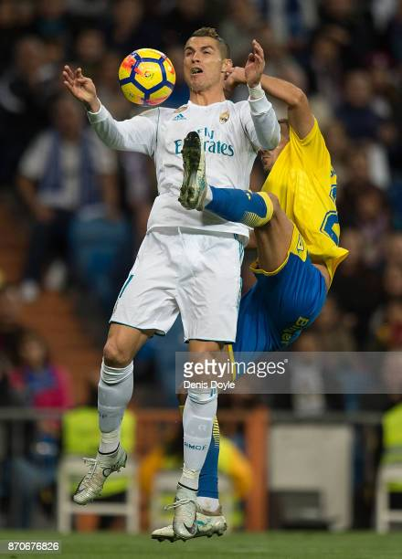 Cristiano Ronaldo of Real Madrid CF is challenged by David Simon of Las Palmasduring the La Liga match between Real Madrid and Las Palmas at Estadio...