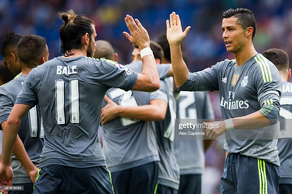 Cristiano Ronaldo (R) of Real Madrid CF is congratulated by his teammate Gareth Bale (L) after scoring his team's sixth goal during the La Liga match between RCD Espanyol and Real Madrid CF at Cornella-El Prat Stadium on September 12, 2015 in Barcelona, Spain.