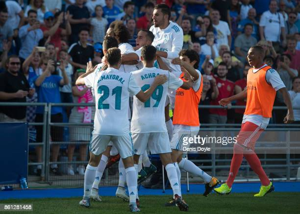 Cristiano Ronaldo of Real Madrid CF is mobbed by teammates after scoring his team's 2nd goal during the La Liga match between Getafe and Real Madrid...