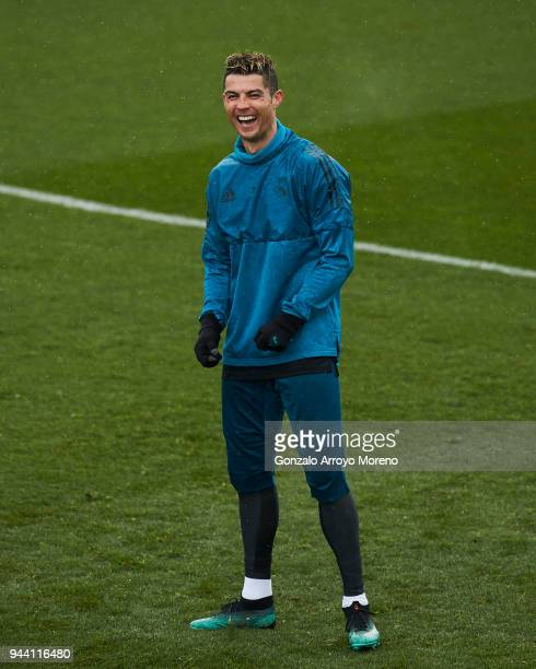 Cristiano Ronaldo of Real Madrid CF jokes with his team mates during a training session ahead of their UEFA Champions LEague quarter final second leg...