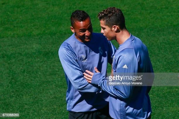 Cristiano Ronaldo of Real Madrid CF jokes with his teammate Danilo Luiz da Silva druing a training session ahead of the UEFA Champions League...