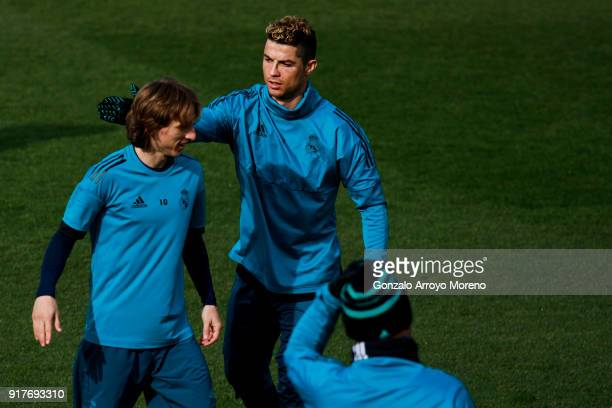 Cristiano Ronaldo of Real Madrid CF jokes with his teammate Luka Modric during a training session at Valdebebas training ground ahead their Round of...