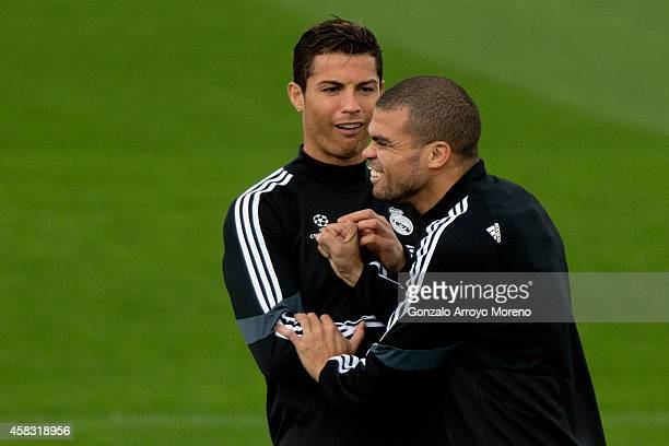 Cristiano Ronaldo of Real Madrid CF jokes with his teammate Pepe during the training session ahead of the UEFA Champions League Group B match between...