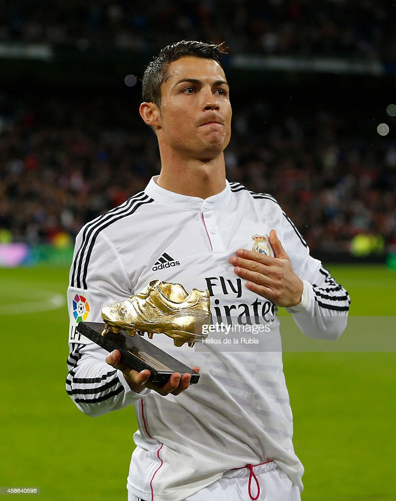Cristiano Ronaldo of Real Madrid CF kisses his third Golden Boot award as best European scorer prior to start the La Liga match between Real Madrid CF and Rayo Vallecano de Madrid at Estadio Santiago Bernabeu on November 8, 2014 in Madrid, Spain.