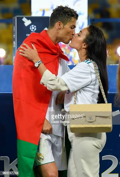 Cristiano Ronaldo of Real Madrid CF kisses hsi girlfriend Georgina Rodriguez as they celebrate his side victory following winning the UEFA Champions...