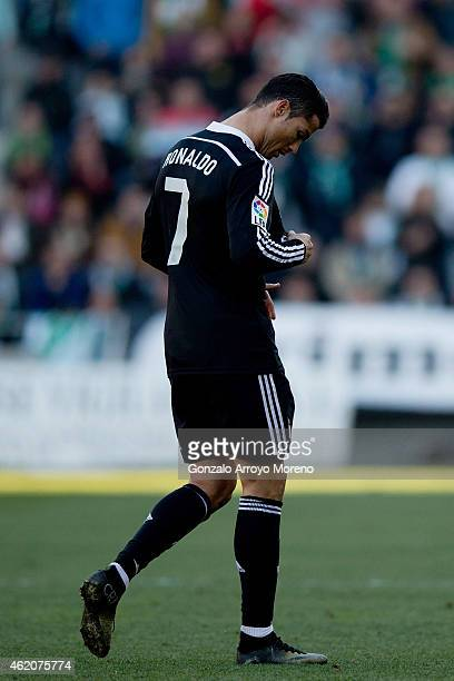 Cristiano Ronaldo of Real Madrid CF leaves the pitch after being reprimanded with a red card during the La Liga match between Cordoba CF and Real...