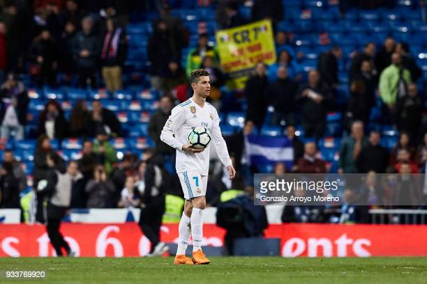 Cristiano Ronaldo of Real Madrid CF leaves the pitch holding the ball after scoring four goals during the La Liga match between Real Madrid CF and...