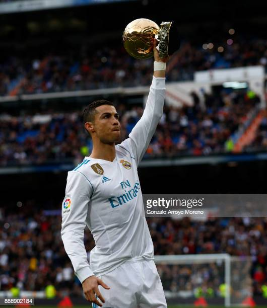 Cristiano Ronaldo of Real Madrid CF offers his fifth Golden Ball trophy to the audience prior to start the La Liga match between Real Madrid CF and...