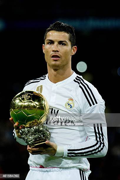 Cristiano Ronaldo of Real Madrid CF offers his third Golden Ball to the audience prior to start the Copa del Rey Round of 16 second leg match between...