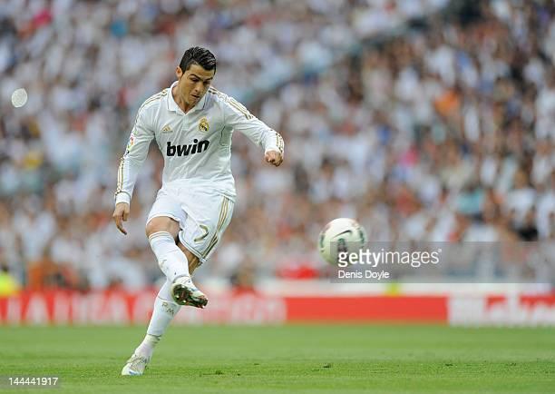 Cristiano Ronaldo of Real Madrid CF passes the ball during the La Liga match between Real Madrid CF and RCD Mallorca at Estadio Santiago Bernabeu on...