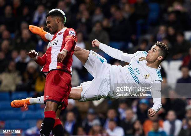 Cristiano Ronaldo of Real Madrid CF performs a scissor kick during the La Liga match between Real Madrid CF and Girona FC at Estadio Santiago...