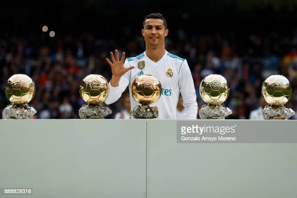 Cristiano Ronaldo of Real Madrid CF poses with his five Golden Ball trophies prior to start the La Liga match between Real Madrid CF and Sevilla FC...