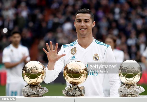 Cristiano Ronaldo of Real Madrid CF poses with his five Golden Ball trophies prior to the La Liga match between Real Madrid CF and Sevilla FC at...