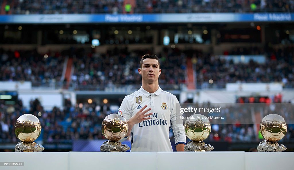 Cristiano Ronaldo of Real Madrid CF poses with his four Golden Balls prior to start the La Liga match between Real Madrid CF and Granada CF at Estadio Santiago Bernabeu on January 7, 2017 in Madrid, Spain.