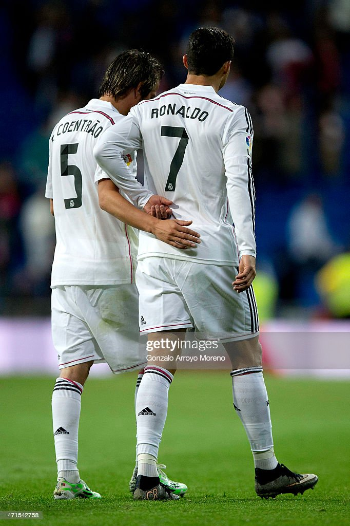 Cristiano Ronaldo (R) of Real Madrid CF pushes away the hand of his his teammate Fabio Coentrao (L) as he tries to embrace him after the La Liga match between Real Madrid CF and UD Almeria at Estadio Santiago Bernabeu on April 29, 2015 in Madrid, Spain.