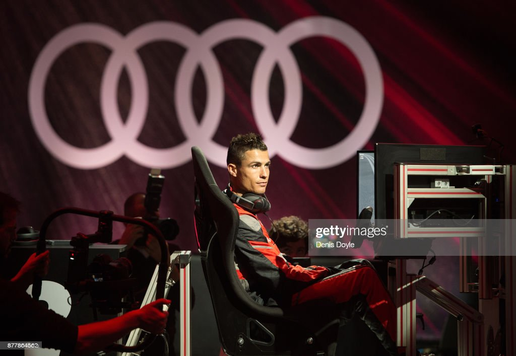 Cristiano Ronaldo of Real Madrid CF races in his simulated Formula-e car during a race with his teammates during the Audi Handover Sponsorship deal with Real Madrid at the Ciudad Deportivo training grounds on November 23, 2017 in Madrid, Spain.