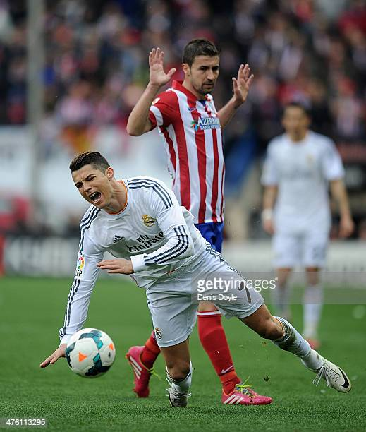 Cristiano Ronaldo of Real Madrid CF reacts after being tackled by Gabi Fernandez of Club Atletico de Madrid during the La Liga match between Club...
