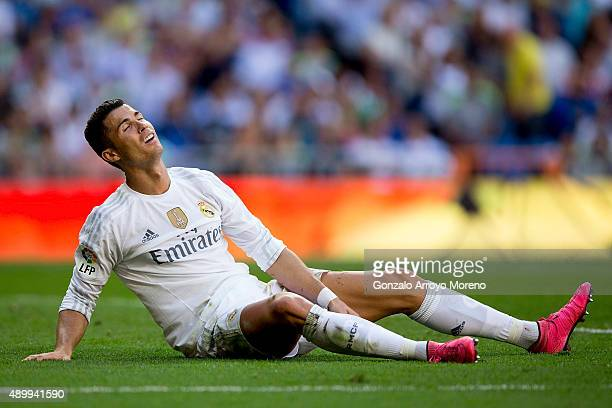 Cristiano Ronaldo of Real Madrid CF reacts after being tackled during the La Liga match between Real Madrid CF and Granada CF at Estadio Santiago...