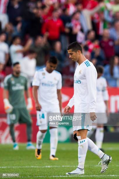 Cristiano Ronaldo of Real Madrid CF reacts after Cristian 'Portu' og Girona FC scores his team's second goal during the La Liga match between Girona...