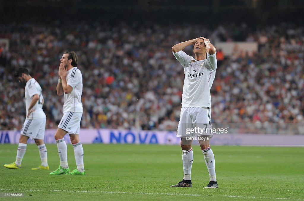 Cristiano Ronaldo of Real Madrid CF reacts after failing to score from a free kick during the La Liga match between Real Madrid CF and Valencia CF at Estadio Santiago Bernabeu on May 9, 2015 in Madrid, Spain.