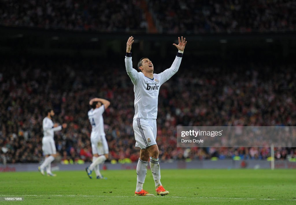 Cristiano Ronaldo of Real Madrid CF reacts after his free kick hits the post during the Copa del Rey Final between Real Madrid CF and Club Atletico de Madrid at Estadio Santiago Bernabeu on May 17, 2013 in Madrid, Spain.