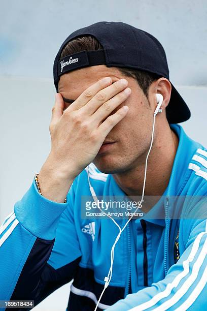 Cristiano Ronaldo of Real Madrid CF reacts annoyed while listen to music on his cell phone with headphones prior to start the La Liga match between...