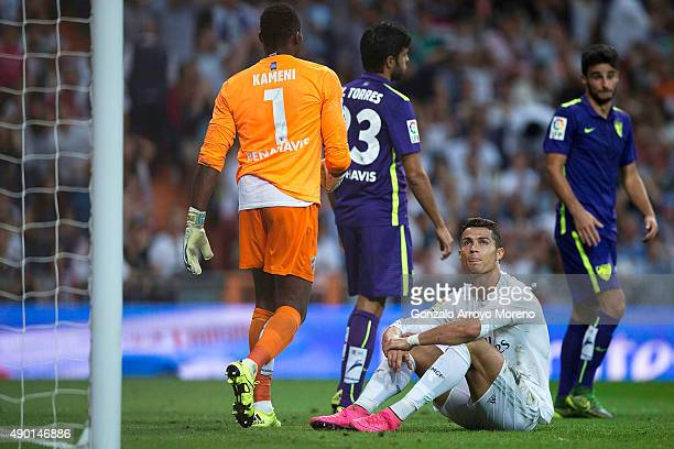Cristiano Ronaldo of Real Madrid CF reacts as he fail to score close to goalkeeper Idriss Carlos Kameni of Malaga CF and his teammate Miguel Torres...