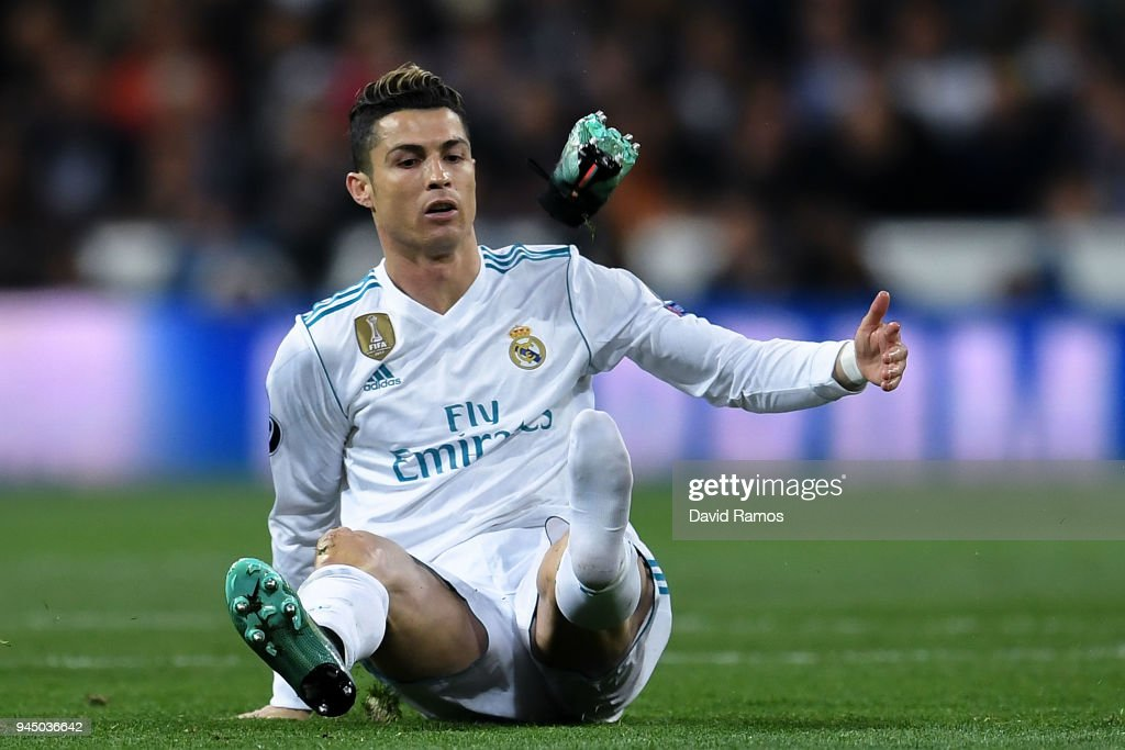 Cristiano Ronaldo of Real Madrid CF reacts as his boot flies through the air during the UEFA Champions League Quarter Final scond leg match between Real Madrid and Juventus at Estadio Santiago Bernabeu on April 11, 2018 in Madrid, Spain.