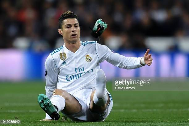 Cristiano Ronaldo of Real Madrid CF reacts as his boot flies through the air during the UEFA Champions League Quarter Final scond leg match between...