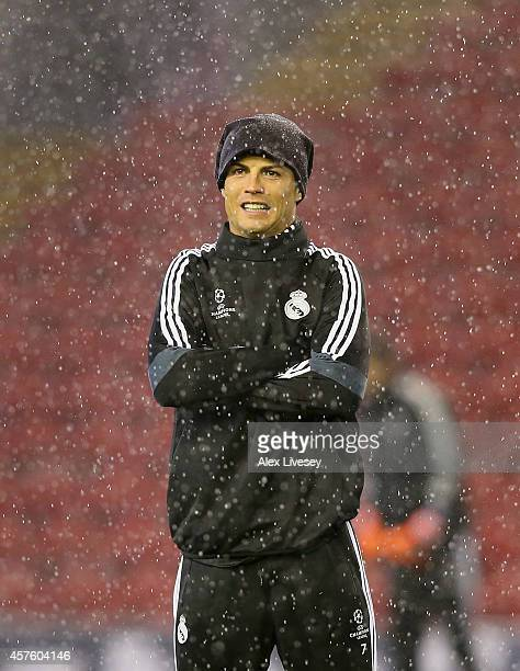Cristiano Ronaldo of Real Madrid CF reacts as it rains during a training session at Anfield on October 21 2014 in Liverpool United Kingdom